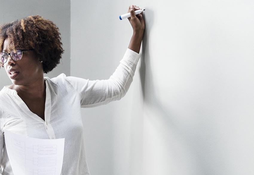 Teacher at a white board